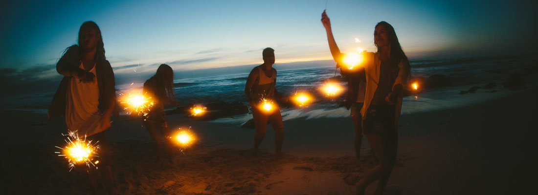 Unique prizes; group with sparklers on beach